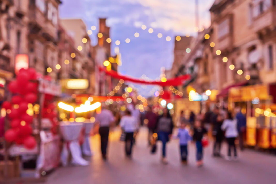 Defocused crowd of people shopping locally during the holiday period.