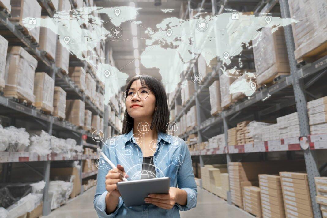 Entrepreneur in warehouse working on holistic omnichannel strategies